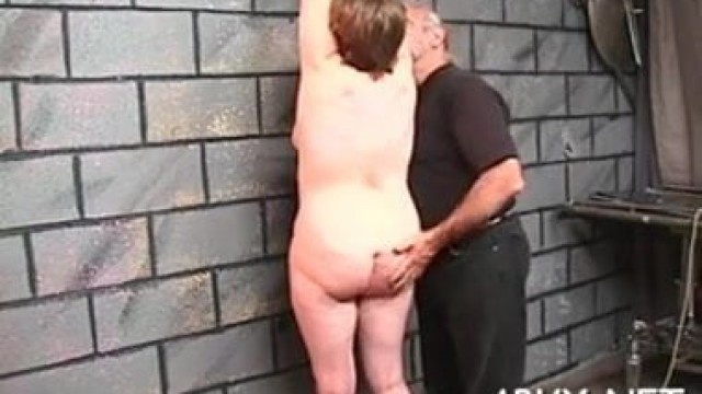 mature slave takes an intense whipping and beating